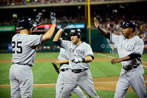 New York Yankees first baseman Mark Teixeira (25), left, congratulates teammates Russell Martin (55), center, and Dewayne Wise (45) after they scored on a Derek Jeter single and a throwing error by Washington Nationals shortstop Ian Desmond in the seventh inning at Nationals Park in Washington, D.C. on Friday, June 15, 2012.  The Yankees won the game 7 - 2..Credit: Ron Sachs / CNP.(RESTRICTION: NO New York or New Jersey Newspapers or newspapers within a 75 mile radius of New York City)