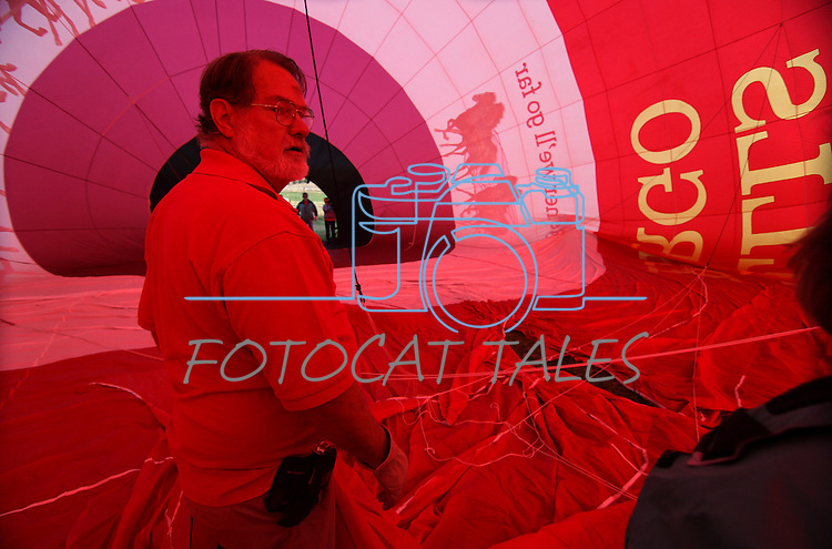 Pilot Don Boyer stands inside his Wells Fargo balloon as it inflates for media day activities at the 30th anniversary of the Great Reno Balloon Race, in Reno, Nev., on Friday, Sept. 8, 2011..Photo by Cathleen Allison