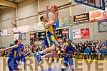 Daragh Jones of Keane's Killorglin goes for the basket on Saturday evening watched by team mate Adam Donoghue while surrounded by Barry Drumm, Neil Baynes & Elijah Mays of UCD Marian