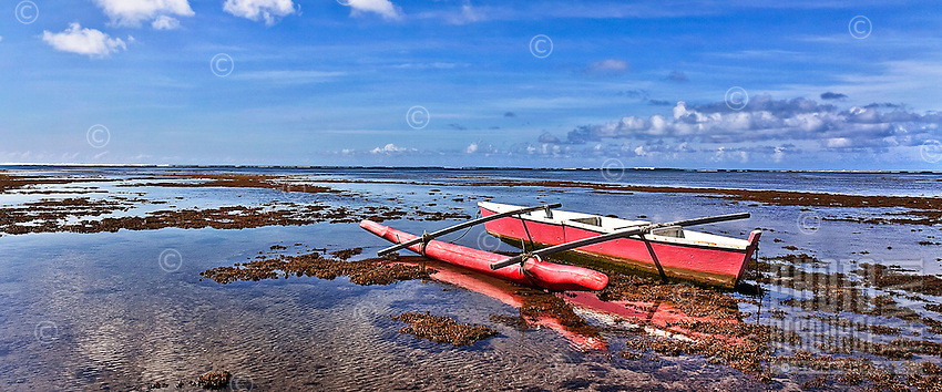 Outrigger canoe grounded at Maunalua Bay, O'ahu