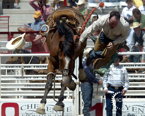Rookie saddle bronc cowboy Pacer Lee samples the thin Cheyenne air as he is tossed from the Harry Vold Rodeo Company bronc Dr. McDreamy during first round Rookie Saddle Bronc Riding competition July 19, 2008 at the 112th annual Cheyenne Frontier Days Rodeo in Cheyenne, Wyoming.