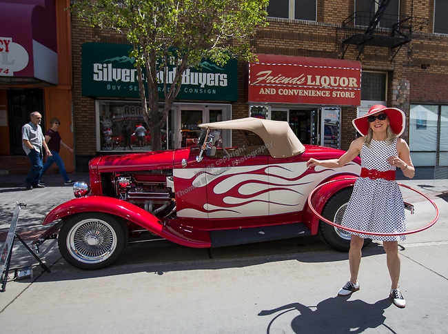Diane Skow from Quincy CA works with a hula hoop in front of her 32 Ford hot rod during Hot August Nights Spring Fever in downtown Reno, Nevada on Friday, May 18, 2018.