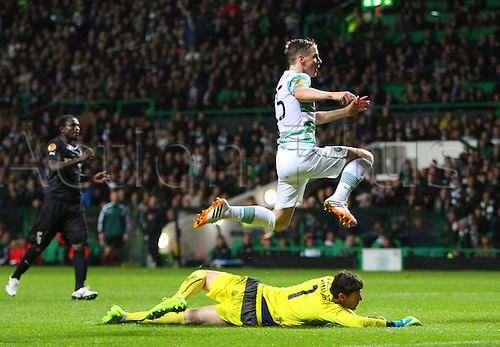 23.10.2014.  Glasgow, Scotland. UEFA Europa League. Celtic versus Astra Giurgiu. Stefan Johansen jumps over Silviu Lung after scoring