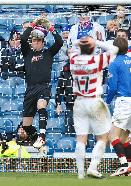 Allan McGregor fumbles Paul McGowan's volley as it slips through his hands and hits him on the face