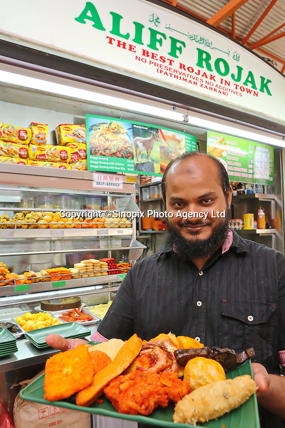 A stall holder from Alif Rojak (an Indonesian food) at the Maxwell Food Centre in Singapore.  Located in the heart of Chinatown, Maxwell Road Hawker Centre has over 100 stalls, providing one of the biggest varieties of local food in Singapore