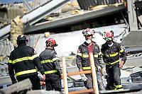Vigili del fuoco al lavoro nelle macerie dell'azienda Haemotronic di Medolla, rasa al suolo dalla scossa di terremoto di ieri 29 maggio 2012, durante il recupero del corpo di un operaio disperso, oggi 30 Maggio 2012. ONE SHOT / INSIDEFOTO
