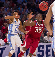 NWA Democrat-Gazette/J.T. WAMPLER Arkansas' Moses Kingsley loses his handle on the ball under pressure from North Carolina's Nate Britt Sunday March 19, 2017 during the second round of the NCAA Tournament at the Bon Secours Wellness Arena in Greenville, South Carolina. The Tar Heels beat the Razorbacks 72-65 eliminating them from the tournament.