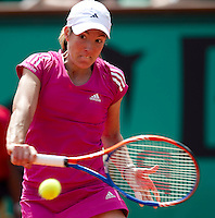 Justine Henin (BEL) (22) against Tsvetana Pironkova (BUL) in the first round of the women's singles. Justine Henin beat Tsvetana Pironkova 6-4 6-3..Tennis - French Open - Day 3 - Tue 25 May 2010 - Roland Garros - Paris - France..© FREY - AMN Images, 1st Floor, Barry House, 20-22 Worple Road, London. SW19 4DH - Tel: +44 (0) 208 947 0117 - contact@advantagemedianet.com - www.photoshelter.com/c/amnimages