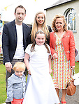 Niamh McArdle who received her first holy communion at St Joseph's Church Mell pictured with dad emmanuel, mam Lisa and brother Joe and sister Roisín. Photo:Colin Bell/pressphotos.ie