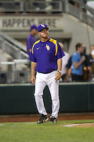 LSU Tigers head coach Paul Mainieri looks on during Game 4 of the 2013 Men's College World Series between the LSU Tigers and UCLA Bruins at TD Ameritrade Park on June 16, 2013 in Omaha, Nebraska. The Bruins defeated the Tigers 2-1. (Brace Hemmelgarn/Four Seam Images)