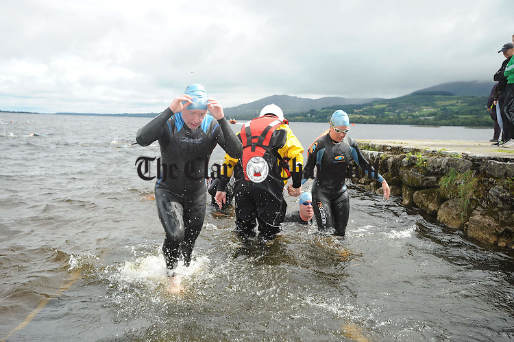 Exiting the water of Lough Derg after completing the 750m swim during the Brian Boru Sprint Triathlon at Two-Mile-Gate,  Killaloe. Photograph by John Kelly.