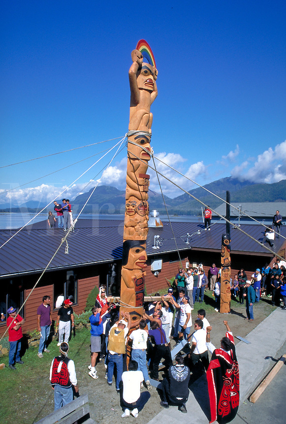 The people of Metlakatla  have raised the totem pole in celebration of the Potlatch