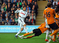 FAO SPORTS PICTURE DESK<br /> Pictured: Danny Graham of Swansea (L) scoring his goal. Saturday, 28 April 2012<br /> Re: Premier League football, Swansea City FC v Wolverhampton Wanderers at the Liberty Stadium, south Wales.