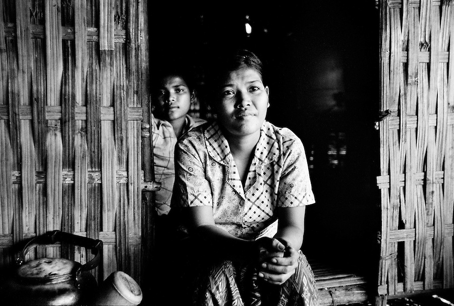 """Mekong Dam Victims - Cambodia. One of the young villagers who has moved to a new location, choosing to remain rather near the river to maintain an easy access to the town and hospital. However, they might have to move again soon because of the fast erosion of the riverbanks. At least 55.000 people living near the Sesan river in Cambodia's Ratanakiri and Stung Treng provinces continue to suffer due to lost rice production, lost fishing income, drowned livestock and damaged vegetable gardens, and so also great economical losses, because of the unpredictable floodings from the Yali Falls Dam on the other side of the border in Vietnam. To this day, flash floodings have caused the deaths of at least 39 villagers from various ethnic minority groups living along the river. Despite this, four other major hydropower projects are now in operation or under construction on the Sesan River in Vietnam. Known as """"The Mother of Waters"""", more than 60 million people depend on the Mekong river and its tributaries for food, fresh water, transport and other aspects of daily life. The construction of big dams is now threatening the life of these people aswell as the vital and unique ecosystem of the river."""