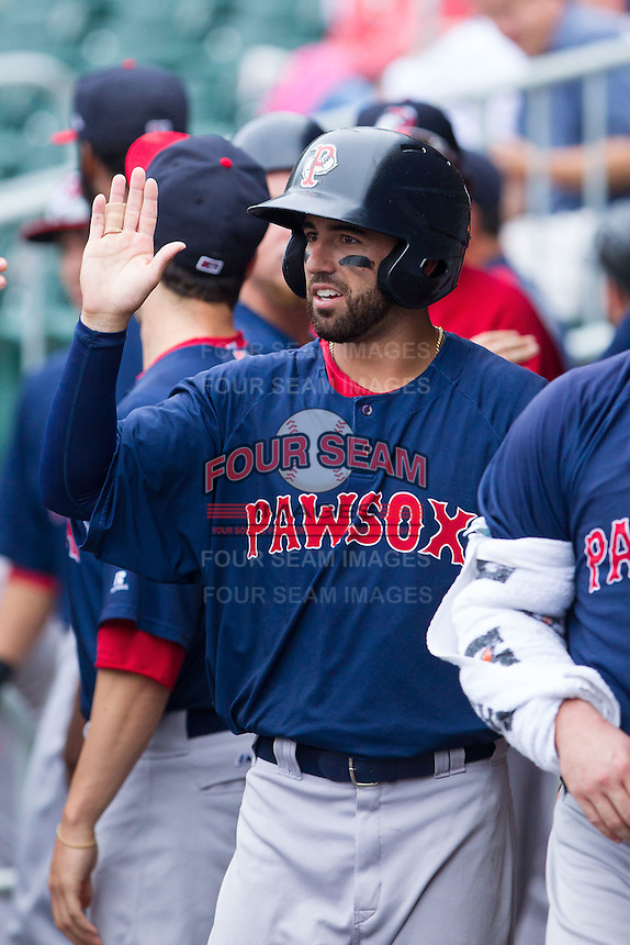Deven Marrero (29) of the Pawtucket Red Sox high fives a teammate during the game against the Charlotte Knights at BB&T Ballpark on August 10, 2014 in Charlotte, North Carolina.  The Red Sox defeated the Knights  6-4.  (Brian Westerholt/Four Seam Images)