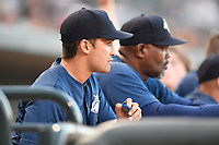 Manager Jose Leger (19), left, and pitching coach Jonathan Hurst (48) of the Columbia Fireflies in a game against the Lexington Legends on Thursday, June 8, 2017, at Spirit Communications Park in Columbia, South Carolina. Columbia won, 8-0. (Tom Priddy/Four Seam Images)
