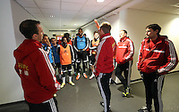 Wednesday, 23 April 2014<br /> Pictured: Head coach Garry Monk (C) in the tunnel speaks to his players before they take to the pitch. <br /> Re: Swansea City FC are holding an open training session for their supporters at the Liberty Stadium, south Wales,