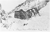 Burns snow slide above Rico when RGS Bridge 64-1 was moved off its footings.  This shows the bridge in its original Howe through-truss design.<br /> RGS  Burns Canyon, CO  after 2/1/1916
