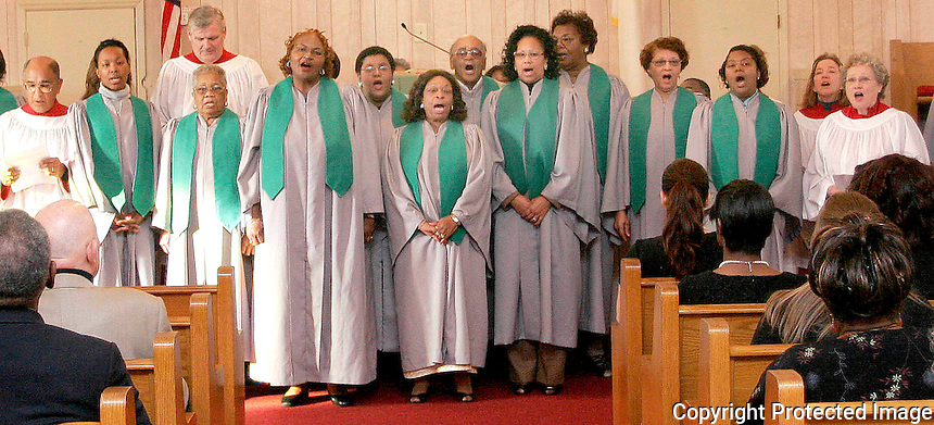 Gary Wilcox/Special...01/18/09...  Members of the St. Andrews AME Church and St. Paul by the Sea Choir sing during the annual Dr. Martin L King Jr. celebration ceremony at St. Andrews AME Church in Jacksonville Beach  Sunday.(01/18/09)..