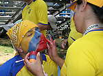 25 June 2006: An Ecuador fan gets his face painted by another fan. England (1st place in Group B) played Ecuador (2nd place in Group A) at Gottlieb-Daimler Stadion in Stuttgart, Germany in match 51, a Round of 16 game, in the 2006 FIFA World Cup.