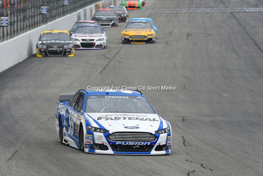 July 13, 2014 - Loudon, New Hampshire, U.S. - Sprint Cup Series driver Carl Edwards (99) heads into a turn at  the NASCAR Sprint Cup Series Camping World RV 301 race held at the New Hampshire Motor Speedway in Loudon, New Hampshire. Eric Canha/CSM