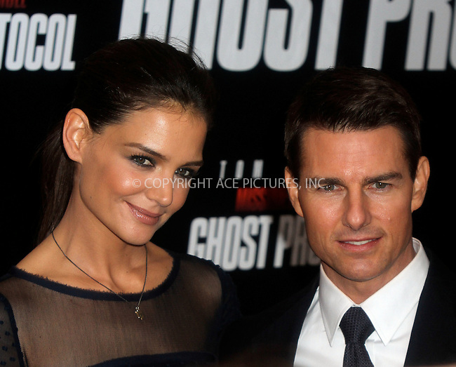 WWW.ACEPIXS.COM . . . . .  ....December 19 2011, New York City....Actors Tom Cruise and Katie Holmes arriving at the 'Mission: Impossible - Ghost Protocol' U.S. premiere at the Ziegfeld Theatre on December 19, 2011 in New York City.....Please byline: NANCY RIVERA- ACEPIXS.COM.... *** ***..Ace Pictures, Inc:  ..Tel: 646 769 0430..e-mail: info@acepixs.com..web: http://www.acepixs.com