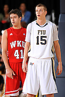 28 January 2012:  FIU center Gilles Dierickx (15) and WKU guard-forward Vinny Zollo (41) wait for play to resume in the first half as the Western Kentucky University Hilltoppers defeated the FIU Golden Panthers, 61-51, at the U.S. Century Bank Arena in Miami, Florida.