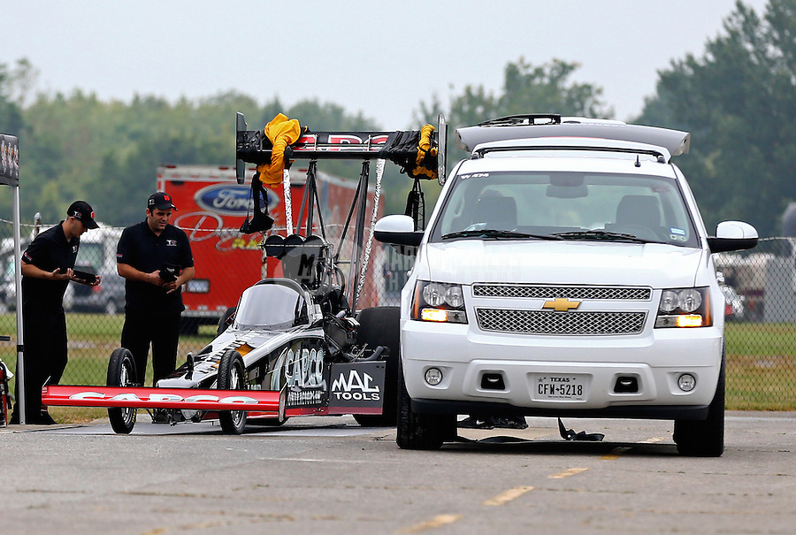 Sept. 2, 2013; Clermont, IN, USA: Crew members for NHRA top fuel dragster driver Billy Torrence during the US Nationals at Lucas Oil Raceway. Mandatory Credit: Mark J. Rebilas-
