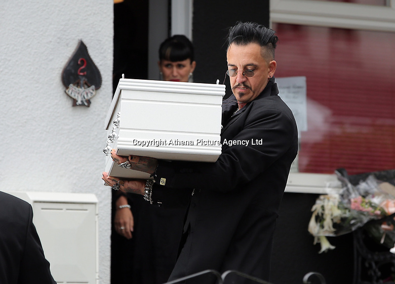 """COPY BY TOM BEDFORD<br /> Pictured: Paul Black carries the white coffin of his daughter Pearl from the family home in Merthyr Tydfil, Wales, UK. Friday 18 August 2017<br /> Re: The funeral of a toddler who died after a parked Range Rover's brakes failed and it hit a garden wall which fell on top of her will be held today at Jerusalem Baptist Chapel in Merthyr Tydfil.<br /> One year old Pearl Melody Black and her eight-month-old brother were taken to hospital after the incident in south Wales.<br /> Pearl's family, father Paul who is The Voice contestant and mum Gemma have said she was """"as bright as the stars""""."""