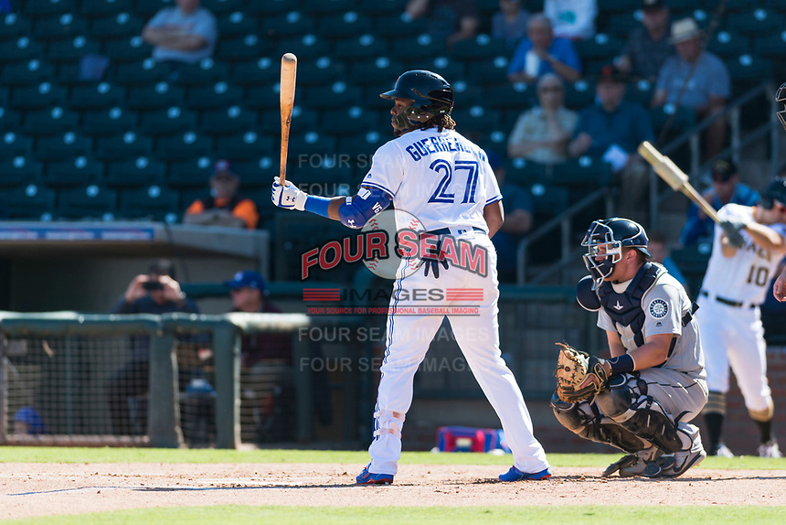 Surprise Saguaros designated hitter Vladimir Guerrero Jr. (27), of the Toronto Blue Jays organization, at bat in front of catcher Joe DeCarlo (4) during an Arizona Fall League game against the Peoria Javelinas at Surprise Stadium on October 17, 2018 in Surprise, Arizona. (Zachary Lucy/Four Seam Images)