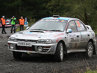 Geoff Goudie / Calum Jaffray retiring at Junction 9 on Craignell, Special Stage 1 of the Ian Broll Merrick Stages Rally 2012, Round 7 of the RAC MSA Scotish Rally Championship which was organised by Machars Car Club and Scottish Sporting Car Club and based in Wigtown on 1.9.12.