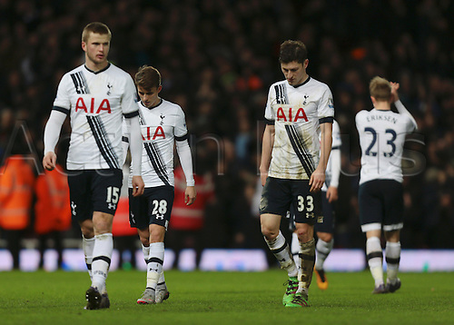 02.03.2016. Boleyn Ground, London, England. Barclays Premier League. West Ham versus Tottenham Hotspur. As Tottenham Hotspur Midfielder Christian Eriksen applauds his fans at full time in the back ground, Tom Carroll,  Ben Davies and Eric Dier look dejected as Tottenham's undefeated league run comes to an end