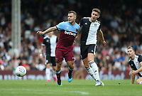West Ham United's Jack Wilshere and Fulham's Tom Cairney<br /> <br /> Photographer Rob Newell/CameraSport<br /> <br /> Football Pre-Season Friendly - Fulham v West Ham United - Saturday July 27th 2019 - Craven Cottage - London<br /> <br /> World Copyright © 2019 CameraSport. All rights reserved. 43 Linden Ave. Countesthorpe. Leicester. England. LE8 5PG - Tel: +44 (0) 116 277 4147 - admin@camerasport.com - www.camerasport.com