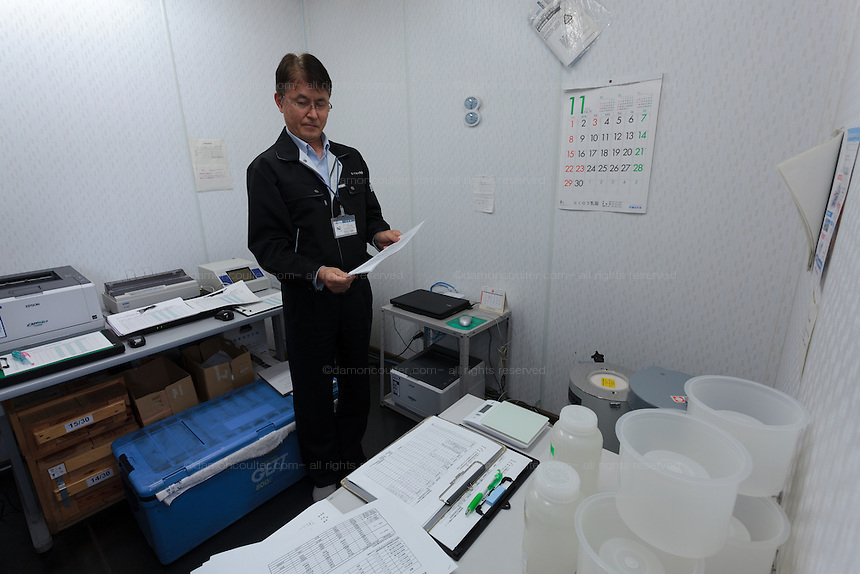 Testing products for radioactive contamination in the Rakuou Milk products factory in Koriyama, Fukushima, Japan Sunday November 22nd 2015