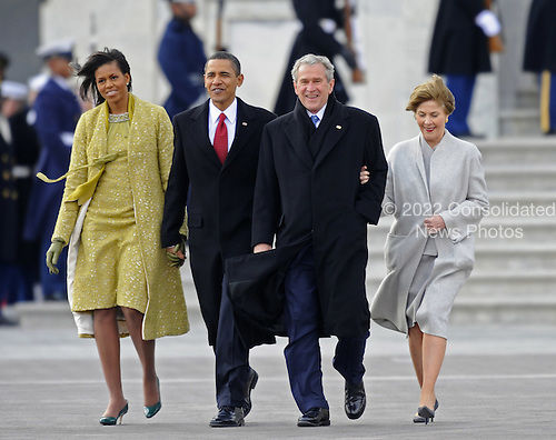 Washington, DC - January 20, 2009 -- Former United States President George W. Bush (2-R) and his wife Laura (R) are escorted to a waiting helicopter by President Barack Obama (2-L) and his wife Michelle as Bush departs from the U.S. Capitol after the swearing in of Obama as the 44th President of the United States during the 56th Presidential Inauguration ceremony in Washington, D.C., USA 20 January 2009..Credit: Tannen Maury - Pool via CNP