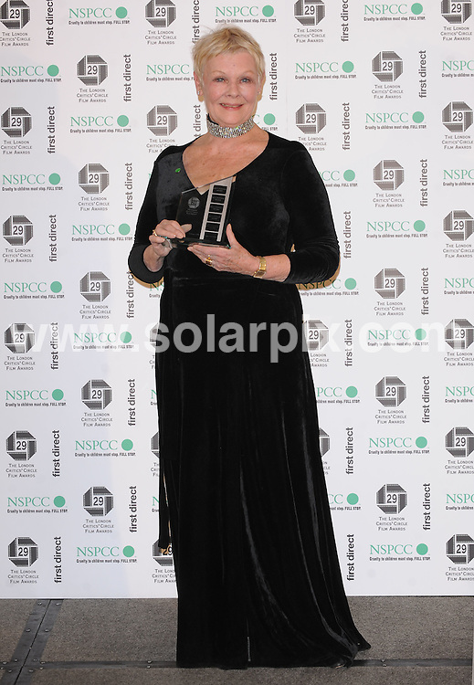 **ALL ROUND PICTURES FROM SOLARPIX.COM**.**WORLDWIDE SYNDICATION RIGHTS**.Red carpet arrivals and Press Room at The London Critics' Circle Film Awards held at the Grosvenor House Hotel, Park Lane, Mayfair, London, UK.  4 February 2009..This pic: Dame Judi Dench..JOB REF: 8397 SSD     DATE: 04_02_2009.**MUST CREDIT SOLARPIX.COM OR DOUBLE FEE WILL BE CHARGED* *ONLINE USAGE FEE £50.00 PER PICTURE - NOTIFICATION OF USAGE TO PHOTO@SOLARPIX.COM*