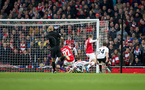 16.02.2014 London, England.  Lukas Podolski of Arsenal scores his sides second goal during the FA Cup 5th Round game between Arsenal and Liverpool from the Emirates Stadium.