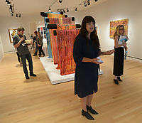 NWA Democrat-Gazette/ANDY SHUPE<br /> Independent curator Candice Hopkins speaks Thursday, Oct. 4, 2018, about a group of textiles by artist Lloyd Kiva New during a tour of a new exhibition of artwork by Native American artists at Crystal Bridges Museum of American Art in Bentonville. The exhibition, titled &quot;Art for a New Understanding: Native Voices, 1950s to Now,&quot; opens today and runs through Jan. 7, 2019.