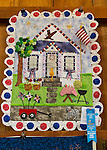 Old Bethpage, New York, U.S. 29th September 2013. This quilt with a cat at the door of a patriotic house, by Mary Dolan, won a FIrst Place blue ribbon from the Agricultural Society of Queens, Nassau and Suffolk Counties at The Long Island Fair. A yearly event since 1842, the county fair is now held at a reconstructed fairground at Old Bethpage Village Restoration.