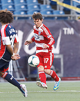 FC Dallas defender Zach Loyd (17) crosses the ball. .  In a Major League Soccer (MLS) match, FC Dallas (red) defeated the New England Revolution (blue), 1-0, at Gillette Stadium on March 30, 2013.