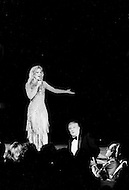 Las Vegas, Nevada, USA, December, 1982 - French Singer Sylvie Vartan with Gene Kelly during a performance at the MGM Hotel. She was accompanied by her mother, her son David, her brother Eddie, and her new love Tony Scotti.