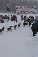 Charlie Allison  leaves the start line of the 2006 Jr. Iditarod race from Willow Lake, Alaska   ..Photo by Ben Schultz