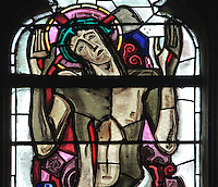 Detail of Christ after his crucifixion wearing the crown of thorns and with his wounds visible, stained glass window, in the Collegiale Notre-Dame de Poissy, a catholic parish church founded c. 1016 by Robert the Pious and rebuilt 1130-60 in late Romanesque and early Gothic styles, in Poissy, Yvelines, France. The Collegiate Church of Our Lady of Poissy was listed as a Historic Monument in 1840. Picture by Manuel Cohen