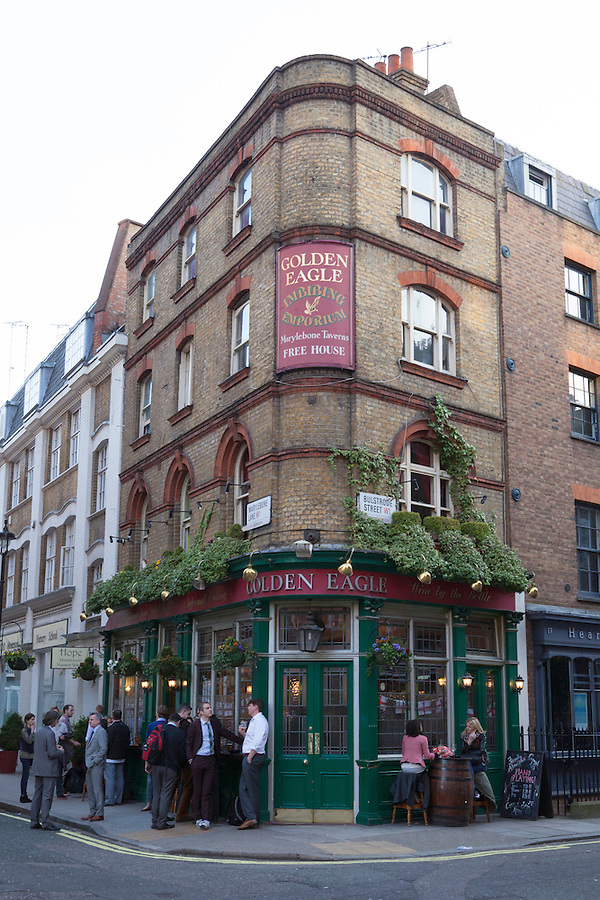 Friends and colleagues gather for happy hour at The Golden Eagle Imbibing Emporium Pub, Marylebone, England, Europe