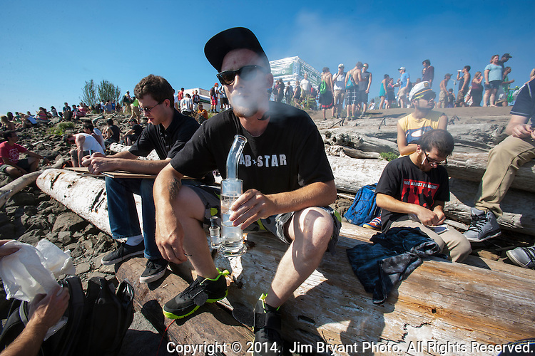 Festival goers  smokes Hash Oil at Hempfest 2014 on the Seattle on August 17, 2014.  Seattle Hempfest, celebrating its 23rd anniversary, features six stages of music, world renowned speakers, hundreds of food, arts, crafts and political booths.   © 2014. Jim Bryant Photo. All rights reserved.