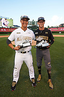 Andy Yerzy (15) of the National team and Carter Kieboom (22) of the American team pose with their teams Most Valuable Player awards after the Under Armour All-American Game presented by Baseball Factory on August 15, 2015 at Wrigley Field in Chicago, Illinois.  The National team defeated the American team 11-5.  (Mike Janes/Four Seam Images)
