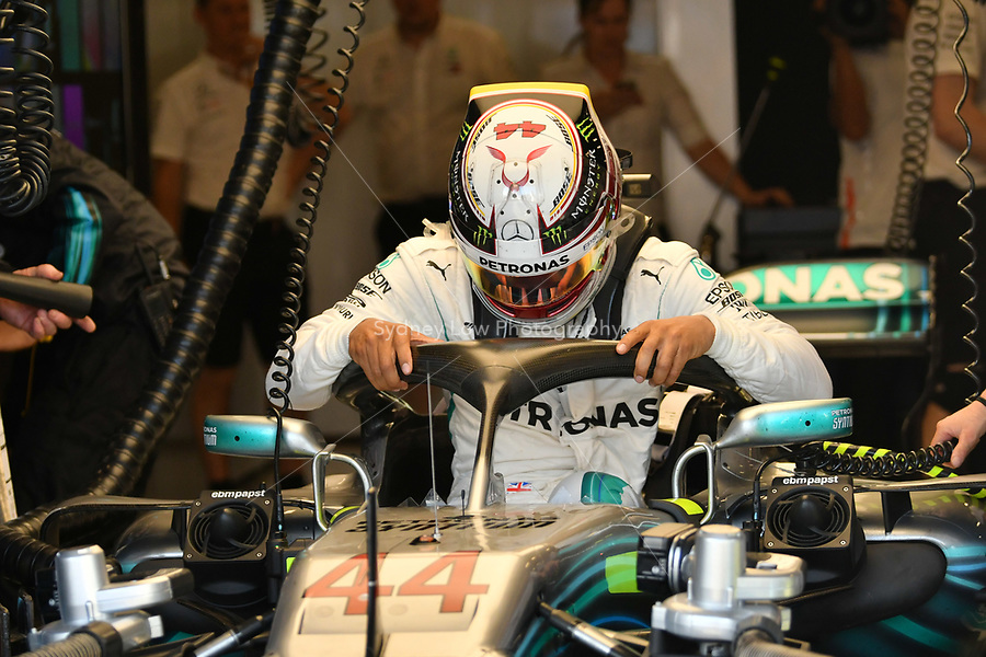 March 23, 2018: Lewis Hamilton (GBR) #44 from the Mercedes AMG Petronas Motorsport team uses the new halo head protection to get out of his car during practice session two at the 2018 Australian Formula One Grand Prix at Albert Park, Melbourne, Australia. Photo Sydney Low