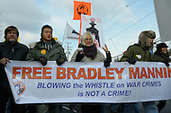 December 17, 2011  (Fort Meade, MD)  Protesters marched outside the Fort Meade military installation in Maryland to show support for Bradley Manning, including Kevin Zeese (far left) and Dan Choi (left).  Manning was at Ft. Meade for his Army Article 32 hearing for allegedly leaking classified intelligence information to the website WikiLeaks. (Photo by Don Baxter/Media Images International)