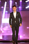 A  male model wearing a suit by Signor Terry at  the Moda sotto le stelle fashion show held in little Italy in Montreal