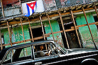 A Cuban man drives in the old Russian car Lada Zhiguli in front of a ruined house in Santiago de Cuba, Cuba, 30 July 2008. About 50 years after the national rebellion, led by Fidel Castro, and adopting the communist ideology shortly after the victory, the Caribbean island of Cuba is the only country in Americas having the communist political system. Although the Cuban state-controlled economy has never been developed enough to allow Cubans living in social conditions similar to the US or to Europe, mostly middle-age and older Cubans still support the Castro Brothers' regime and the idea of the Cuban Revolution. Since the 1990s Cuba struggles with chronic economic crisis and mainly young Cubans call for the economic changes.